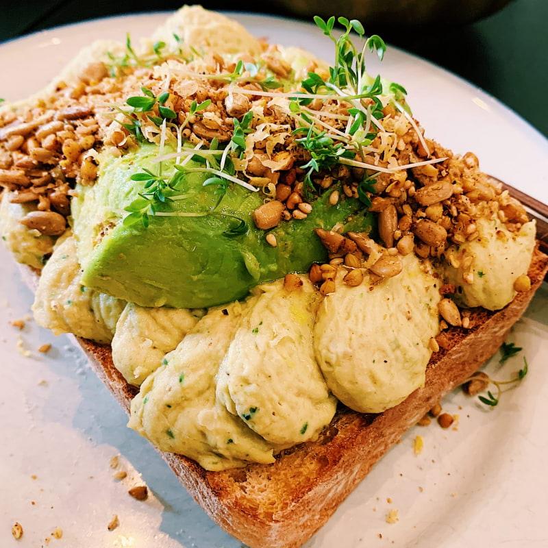 "VEGAN ""GREEN GODDESS""- Hummus, toast, avocado, lemon zest & ras el hanout sprinkles (75kr) – Photo from Pom & Flora Odengatan by Oksana C."