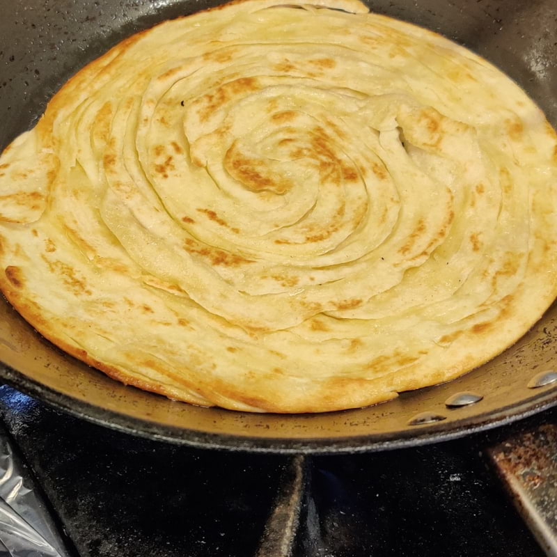 Nybakad Lacha Paratha – Photo from Spice Villa by Shahzad A.